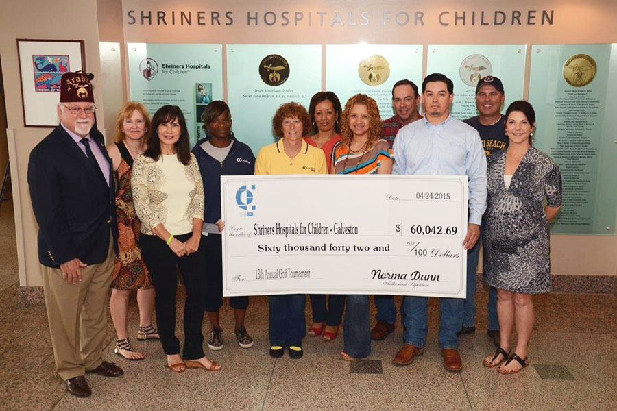 Calpine employee volunteers presented part of the proceeds from the 2014 golf tournament to Shriners Hospital for Children – Galveston.